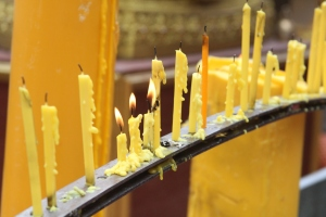 some candles inside the doi suithep temple - my attempt at an artistic shot.