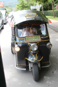 a three person thai tuktuk. super cheap, and super convenient! the drivers are so nice (: